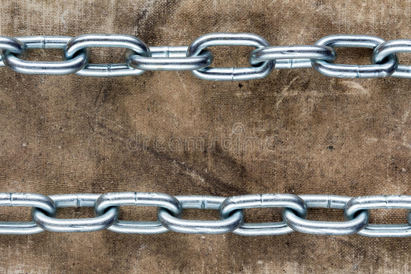 Two chains crossing old book cover royalty free stock photo
