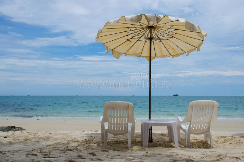 Two chair with umbrella. On beach royalty free stock image