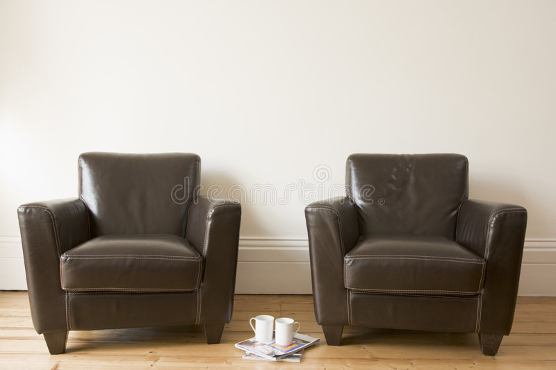 Two chairs with coffee mug and magazines stock photos