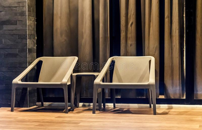 Two chairs in front of curtain stock image