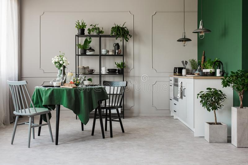 Two chairs at round table set for breakfast in contemporary open plan kitchen stock photography