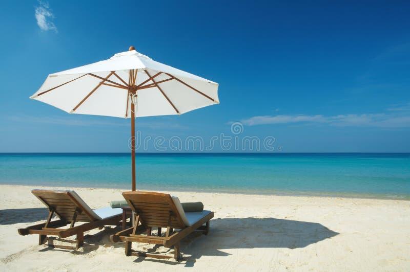 two chairs & umbrella stock photos