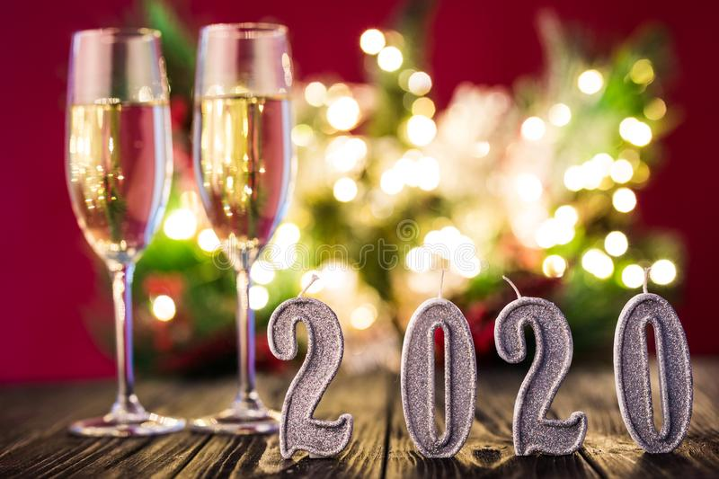 New Year decoration. Two gobelts with champagne with Christmas or New Year 2020 decoration on red light background royalty free stock images