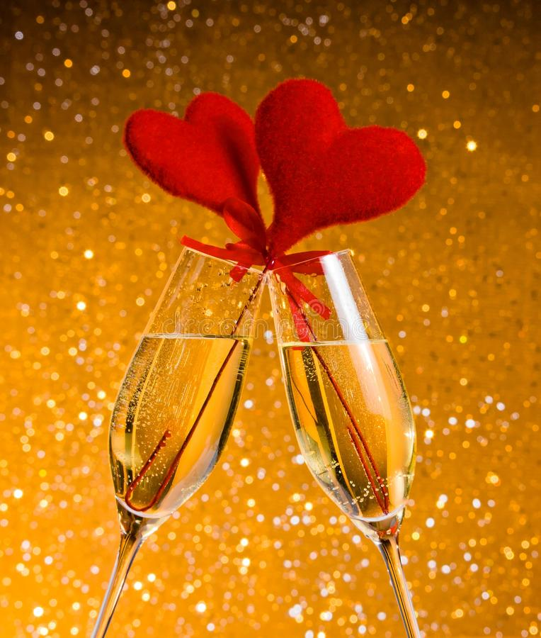 Download Two Champagne Flutes With Golden Bubbles And Red Velvet Hearts Make Cheers On Golden Bokeh Background Royalty Free Stock Image - Image: 36669606