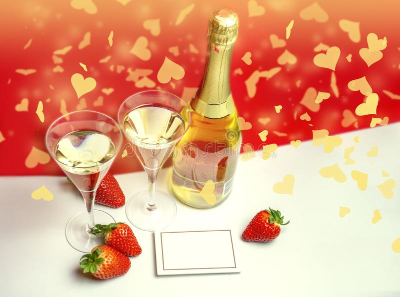 Two champagne glasses with strawberries and light shower copy space. Valentine`s Day concept royalty free stock image