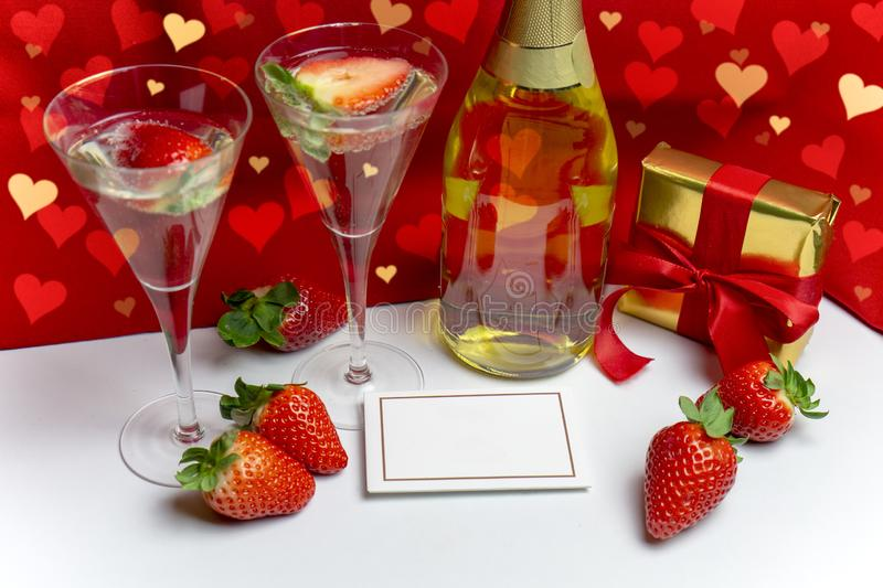 Two champagne glasses with strawberries and light shower copy space. Valentine`s Day concept stock photo
