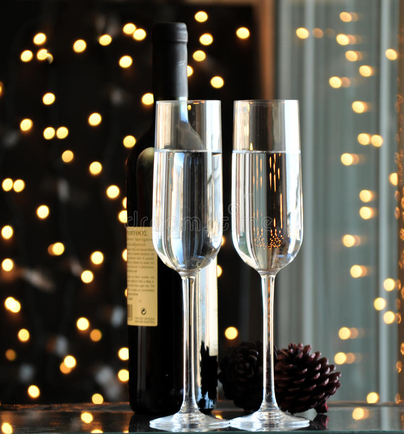 Two champagner glasses on glass table with black bokeh background. Two champagner glasses on glass table with black background stock photos