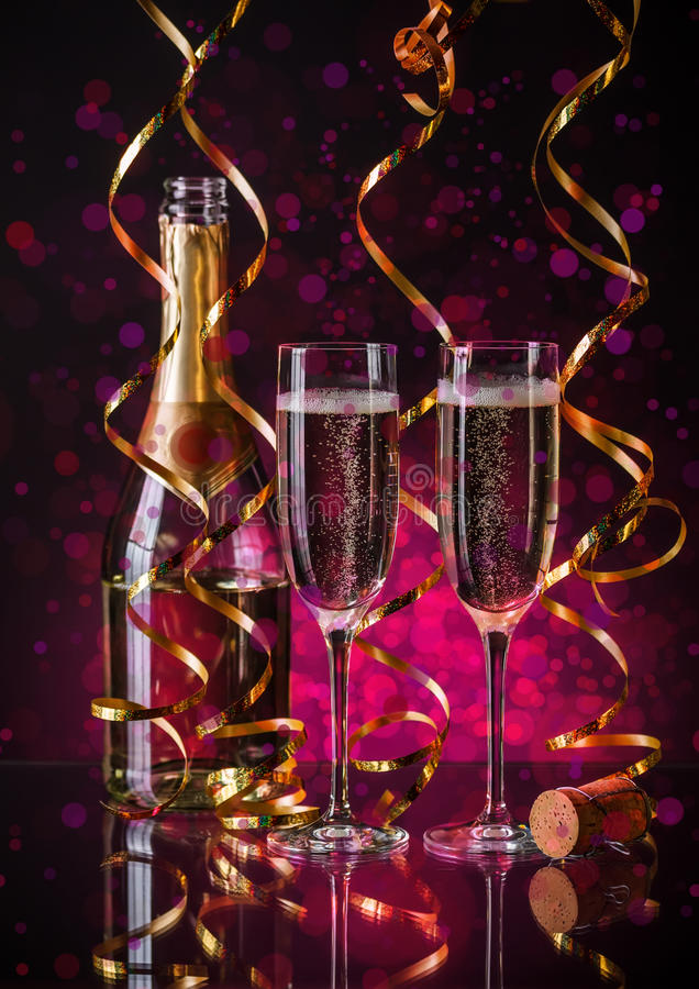 Two champagner glasses. On glass table with bokeh background stock photo