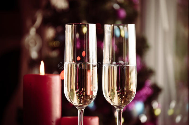 Two champagner glasses on glass table with bokeh background. And lights royalty free stock image