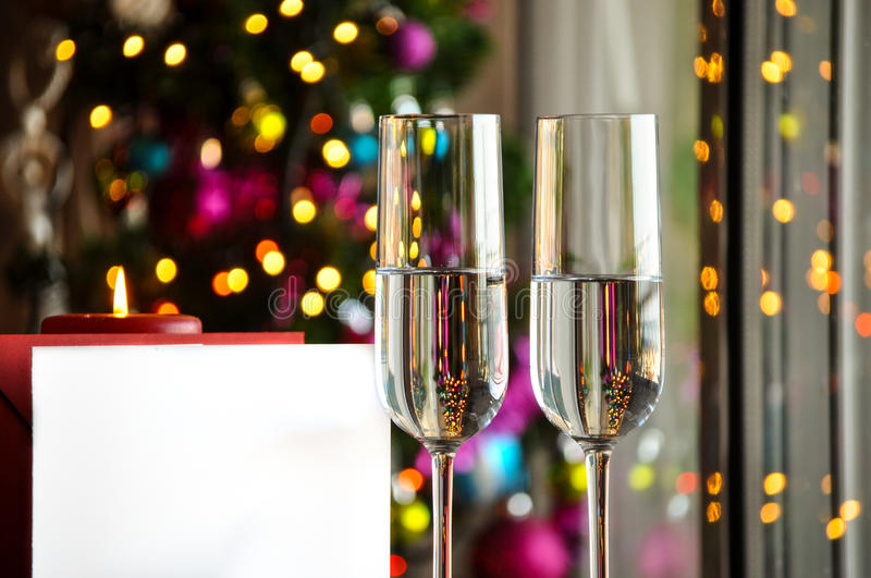 Two champagner glasses on glass table with bokeh background. And lights stock photos