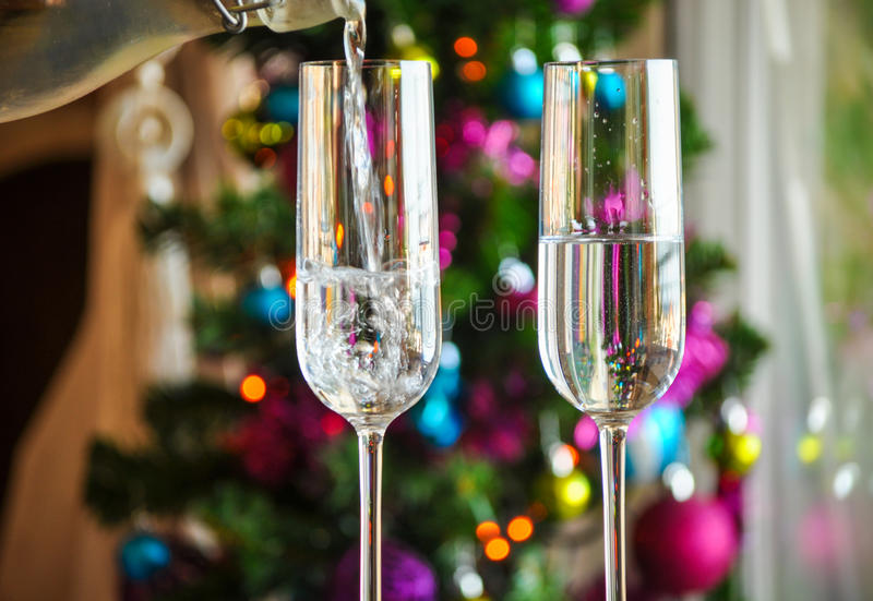 Two champagner glasses on glass table with bokeh background. And lights royalty free stock images