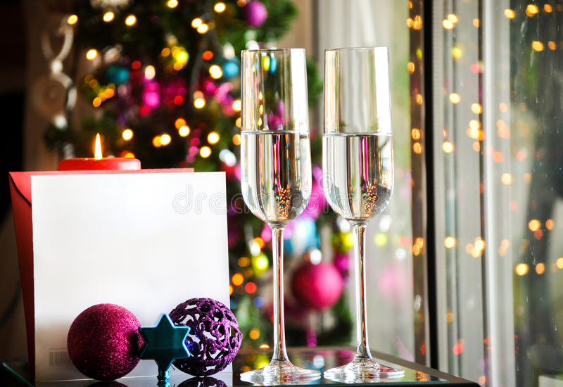 Two champagner glasses on glass table with bokeh background with place for text. Two champagner glasses on glass table with bokeh background and lights royalty free stock images