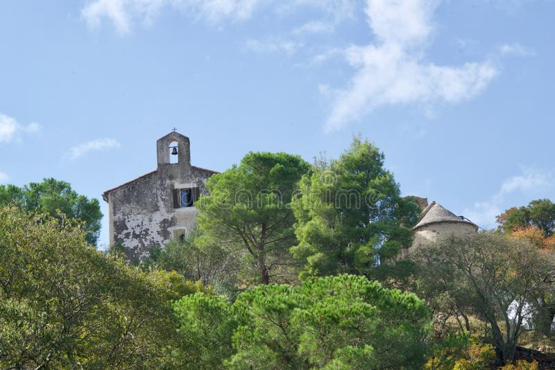 Medieval chapel. Two chapels of Argeles sur Mer behind pines royalty free stock images