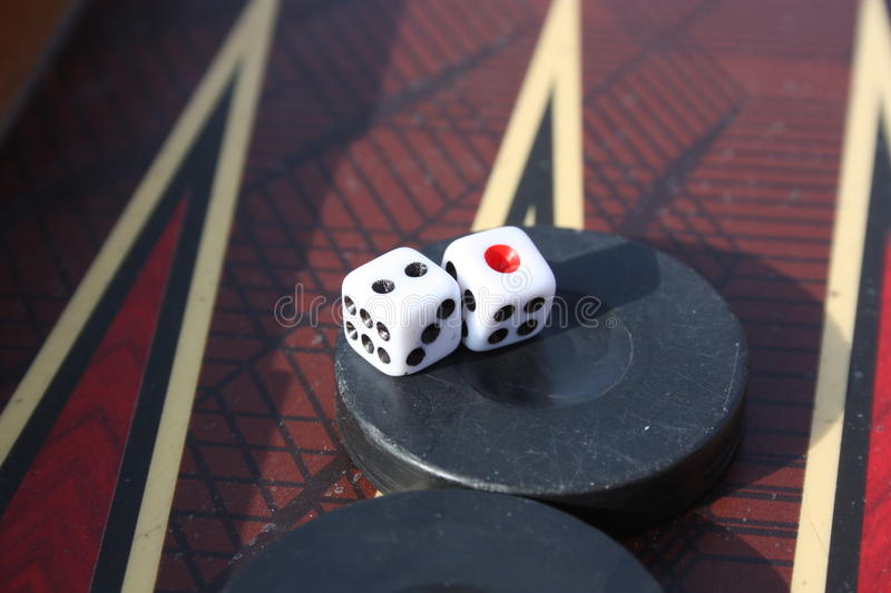 Two checkers and two dices royalty free stock image
