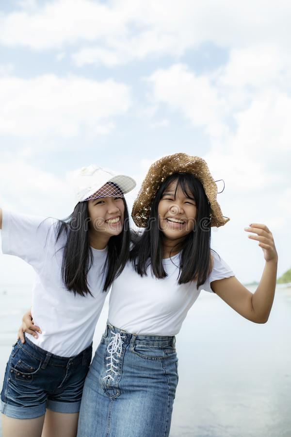 Two cheerful asian teenager happiness on vacation sea beach. Two cheerful asian teenager  happiness on vacation sea beach royalty free stock photos