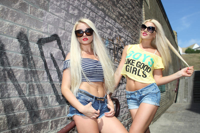 Two cheerful blondes stock photo