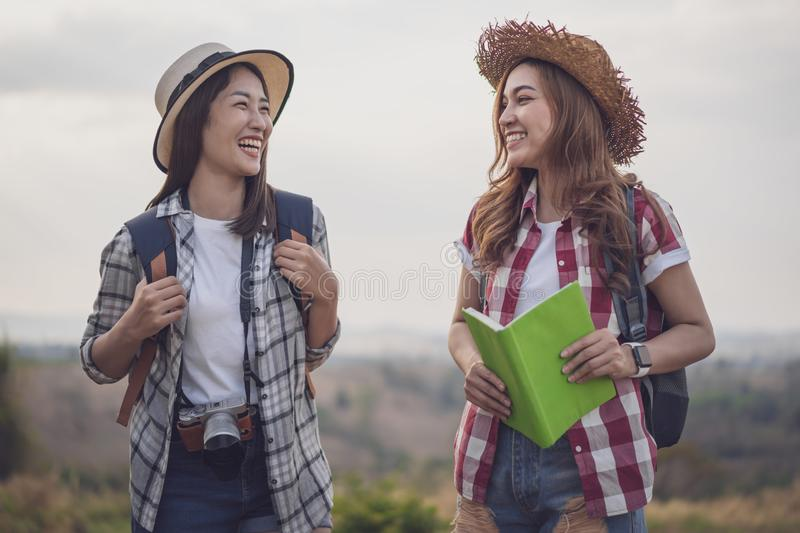 Two cheerful female traveller in countryside. Two cheerful female traveller in the countryside royalty free stock photo