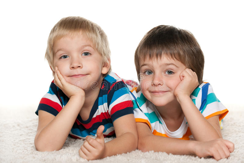 Two cheerful friends on the white carpet stock image