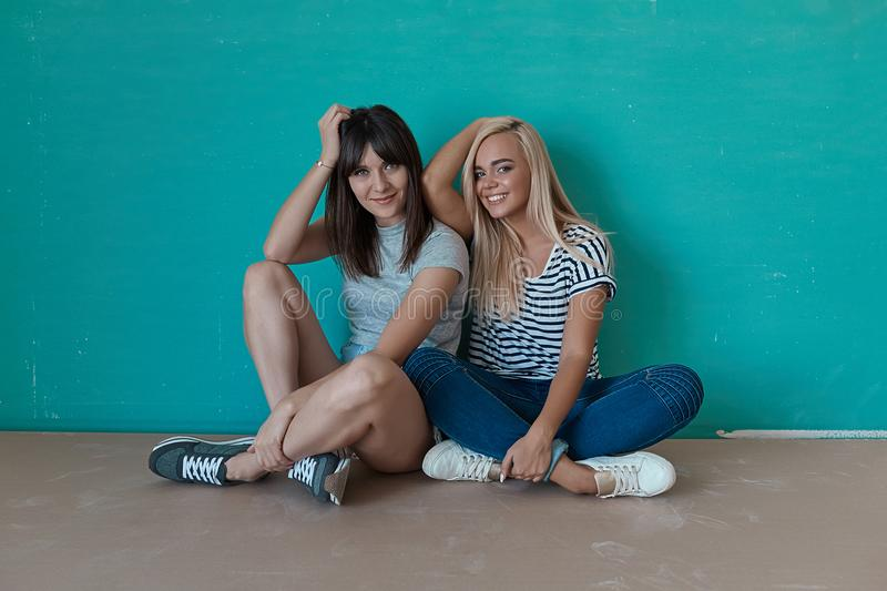 Two cheerful girls enjoy each others company royalty free stock photography