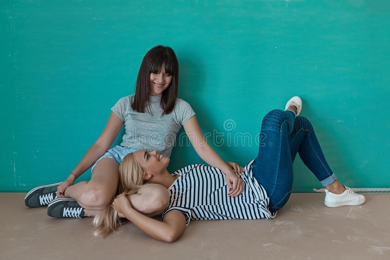 Two cheerful girls enjoy each others company royalty free stock images