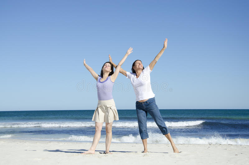 Two cheerful happy women at the beach stock images