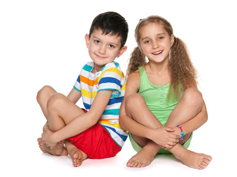Two cheerful kids on the white stock photos