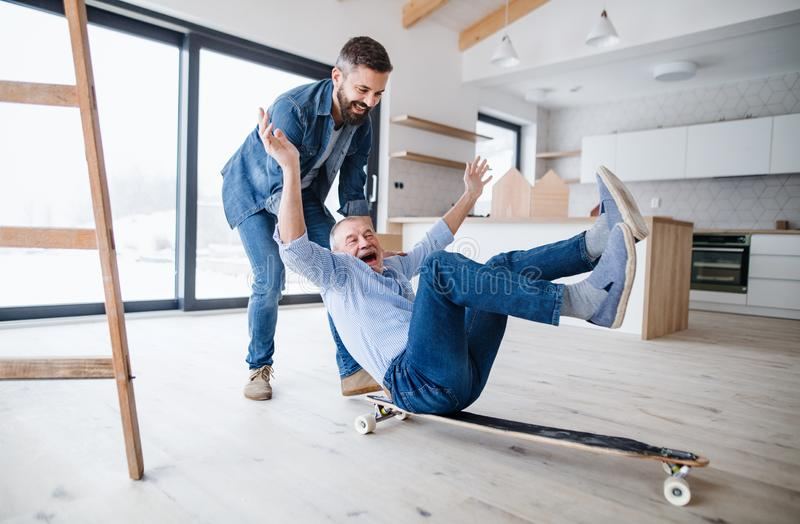 Two men having fun when furnishing new house, a new home concept. stock photo