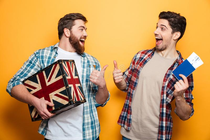 Two cheerful men in shirts preparing to trip royalty free stock image
