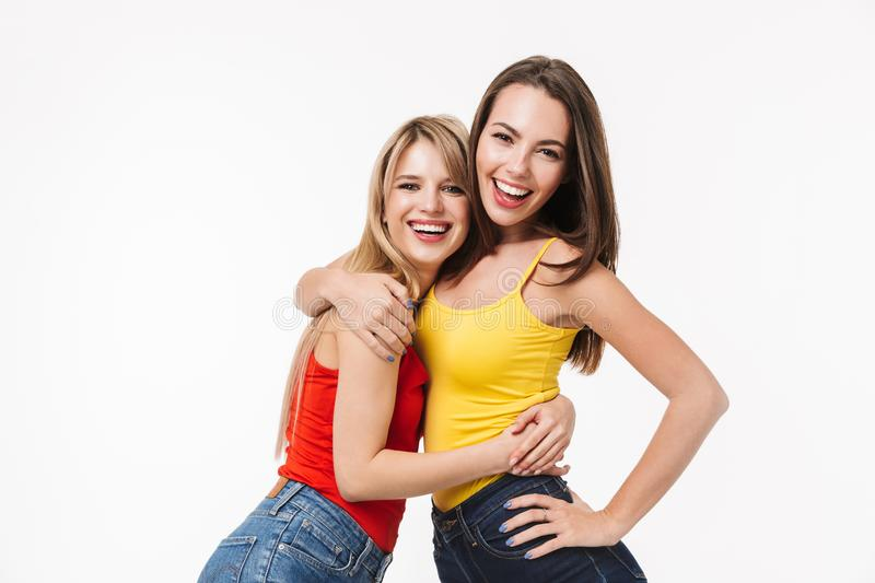 Two cheerful pretty young girls isolated stock images