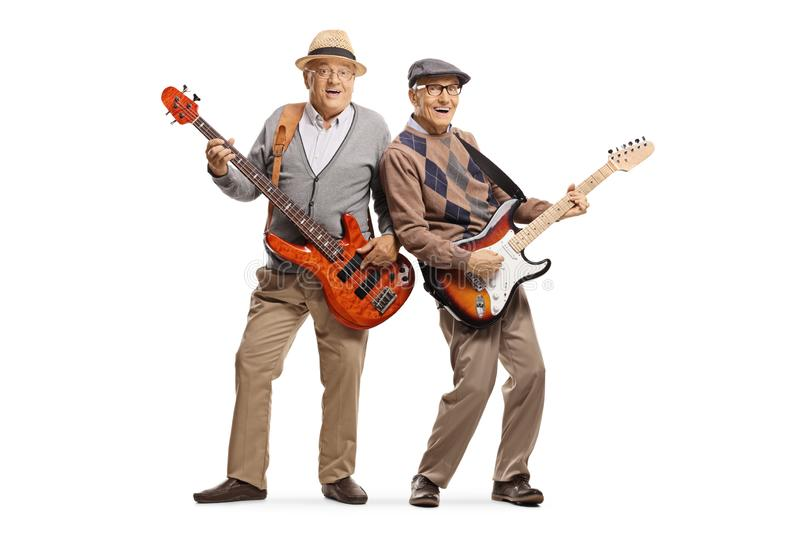 Two cheerful senior men playing electric guitars stock photos