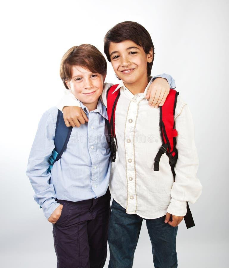 Two cheerful teenagers stock photo