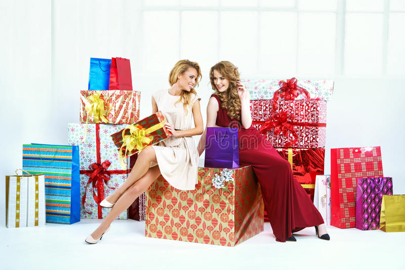 Two cheerful women with presents stock image