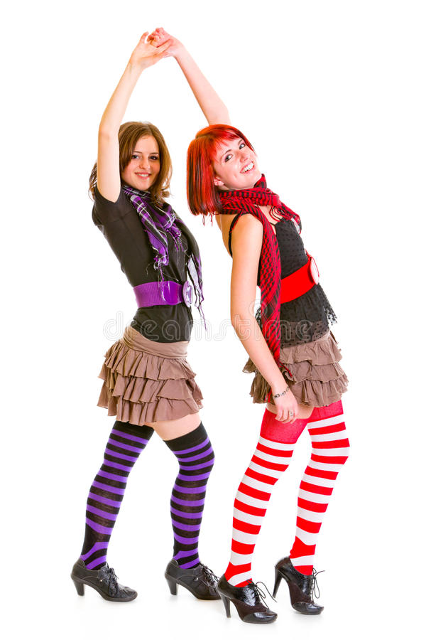 Two cheerful young girlfriends dancing for fun stock photo