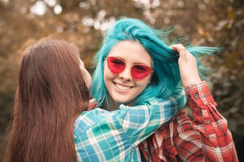 Two young women having fun in forest stock photo