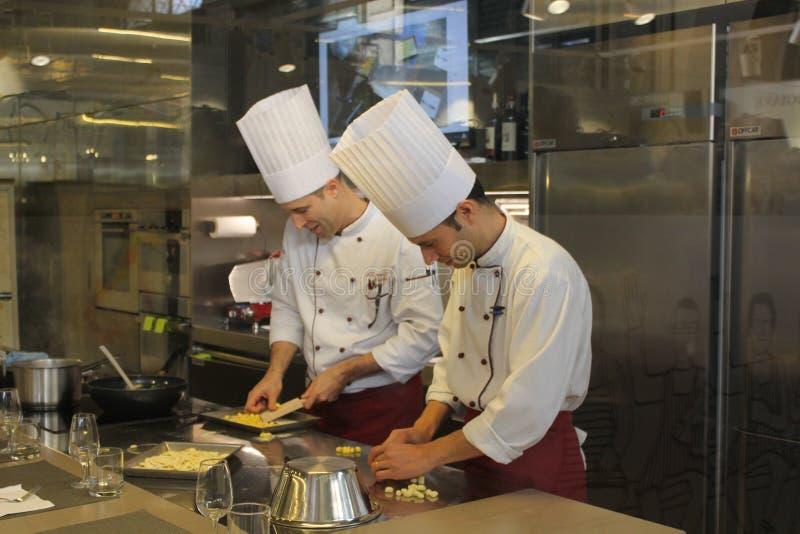 Two chefs preparing homemade pasta stock photography