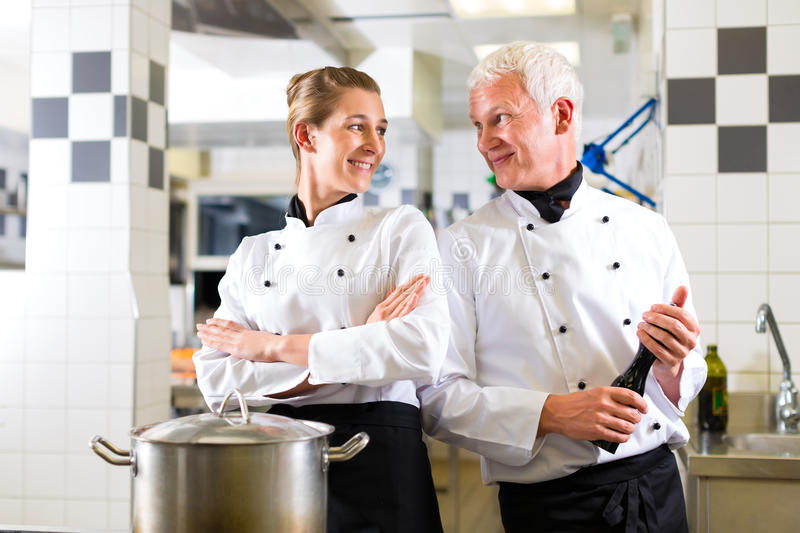 Download Two Chefs In Team In Hotel Or Restaurant Kitchen Stock Photo - Image: 26166618