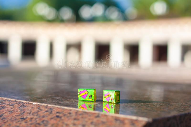 Two chewing gums `Love is` for free royalty free stock images