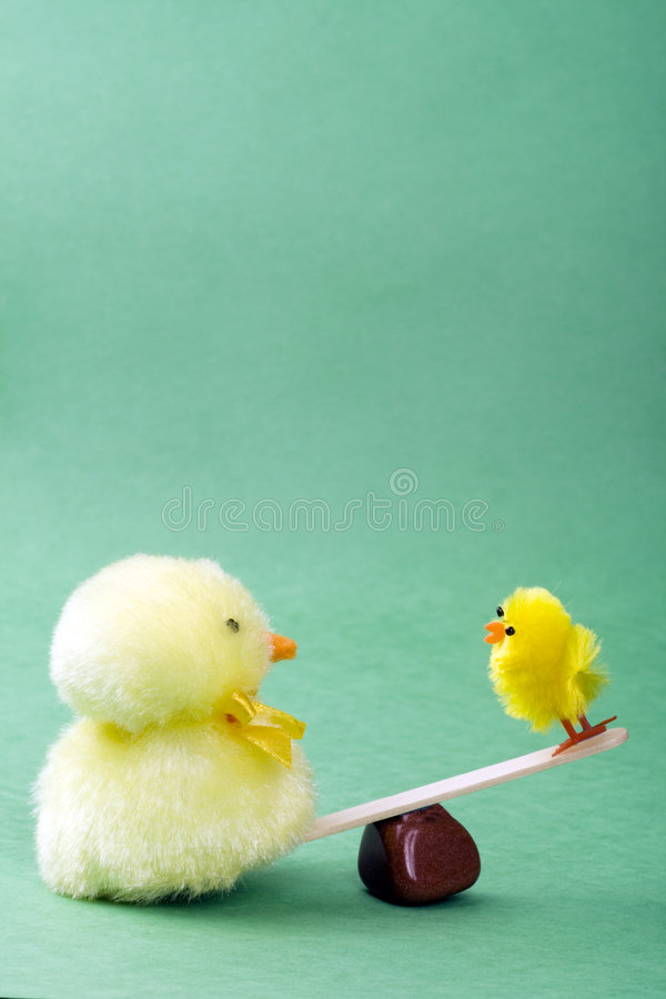Two chicks on a see saw stock photography