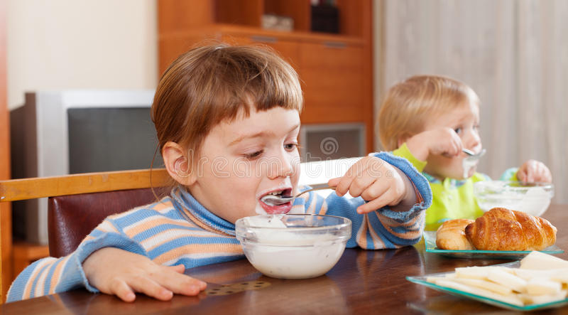 Two  Children Eating Dairy Breakfast Stock Photo