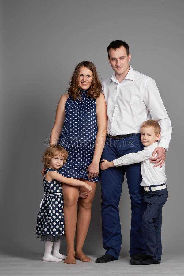Two children father and pregnant mother. Happy family. two children father and pregnant mother stock photo