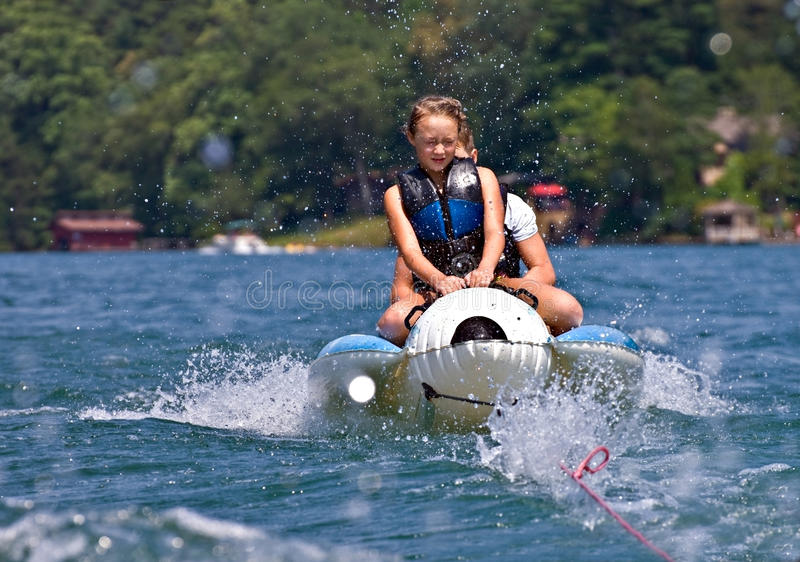 Download Two Children on a Float stock image. Image of leisure - 25847367