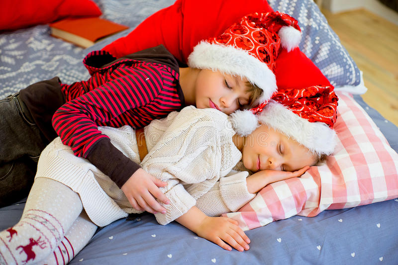 Two children get sleepy till they await christmas stock photo