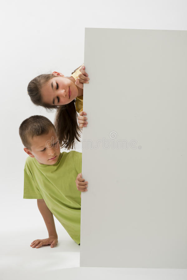 Two Children Holding A Blank Sign Royalty Free Stock Image