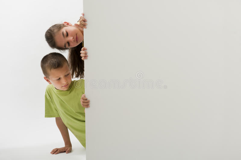 Two Children Holding A Blank Sign Stock Photos