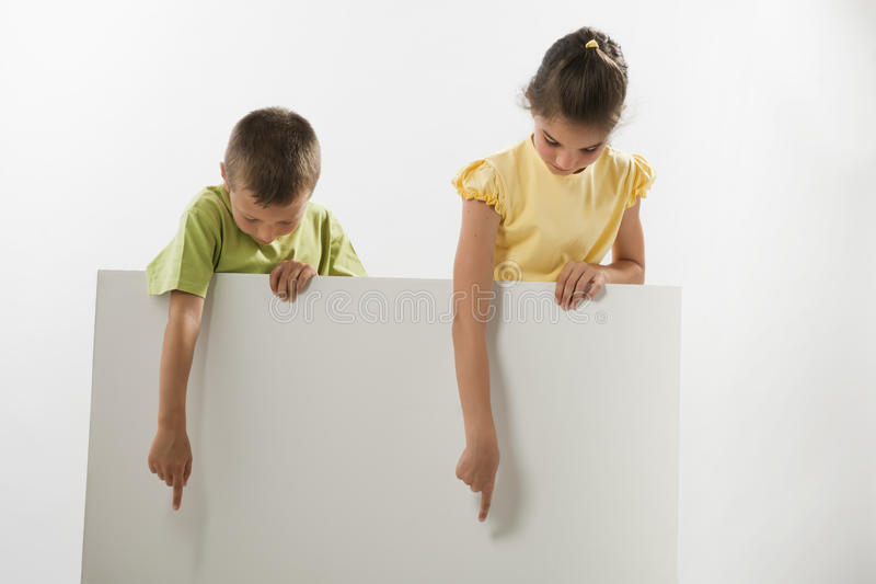 Download Two Children Holding A Blank Sign Stock Photos - Image: 25825813