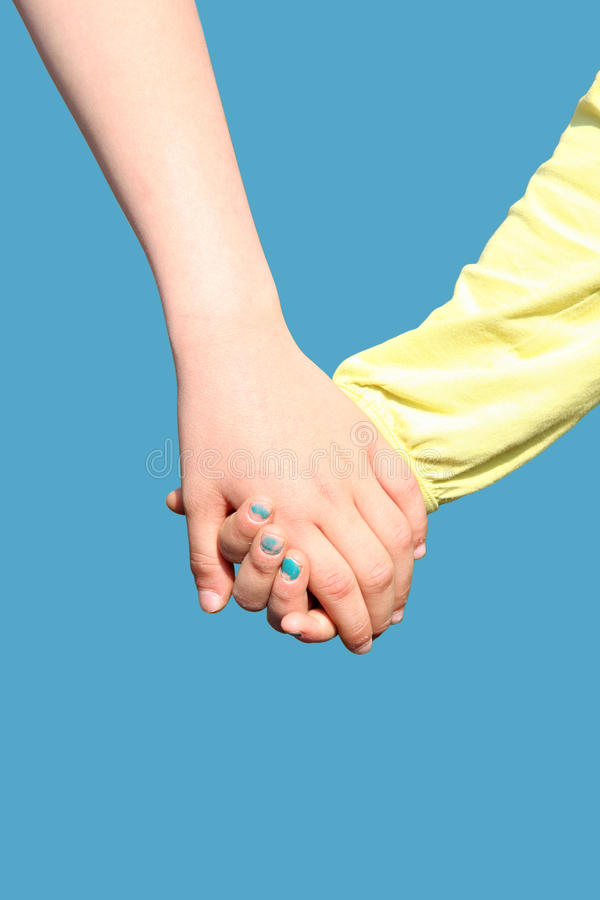Two children holding hands stock image