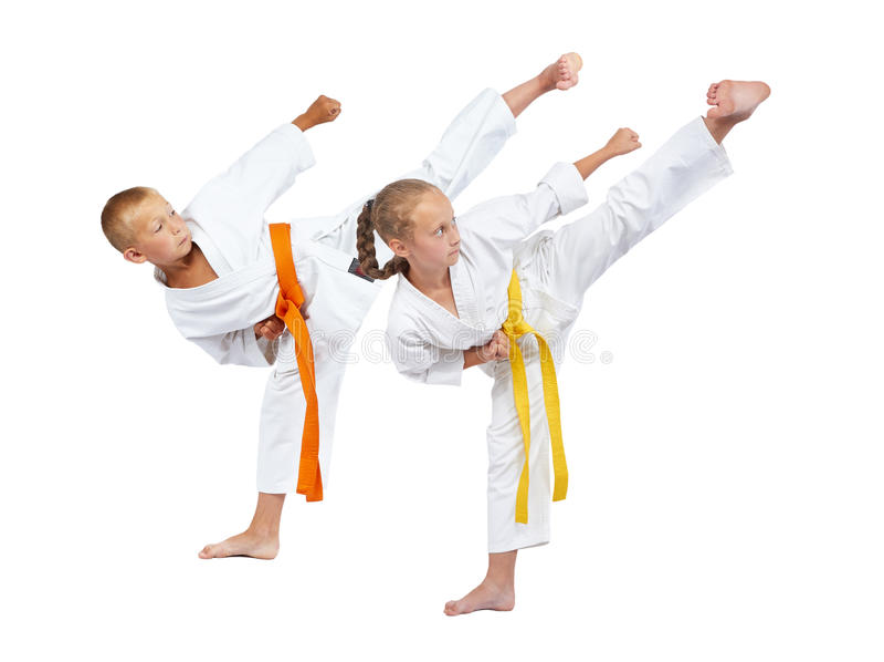 Two children in karategi beats Yoko geri royalty free stock photography