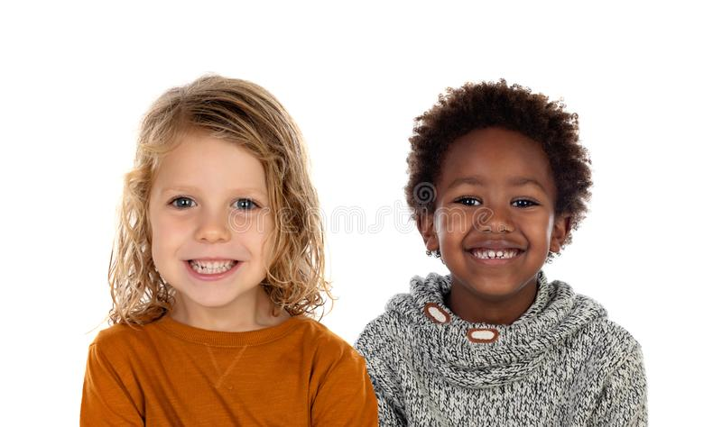 Two children looking at camera stock images