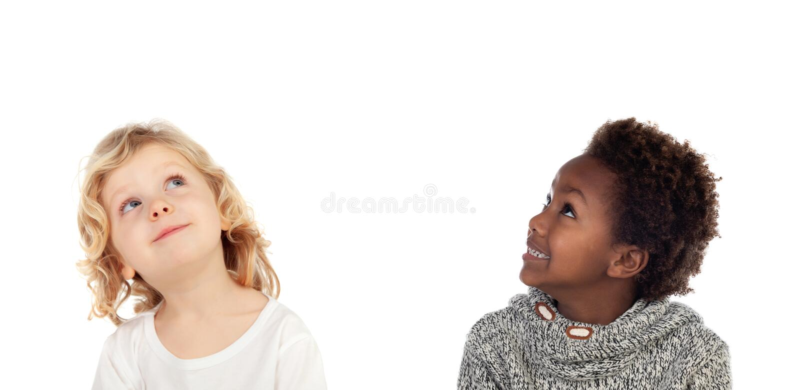 Two children looking up stock photos