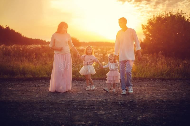 Family with children at sunset stock image